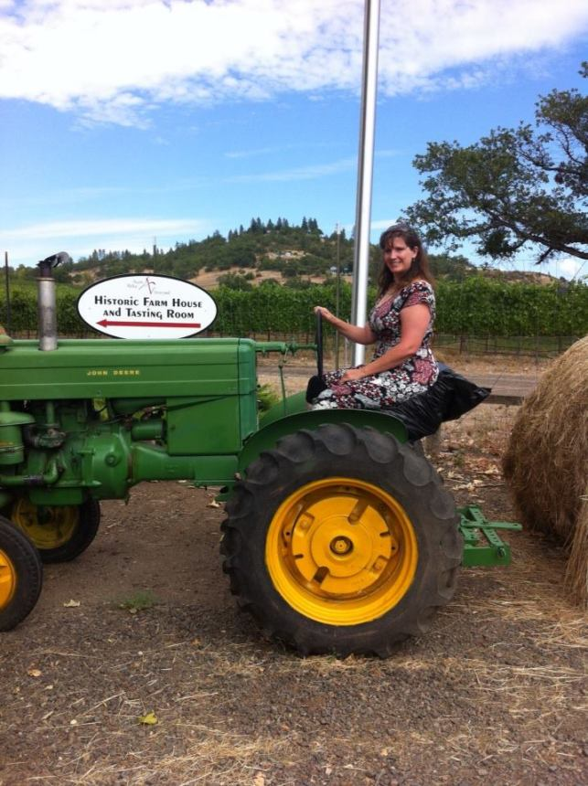 Couldn't resist climbing on the tractor at the winery in my Anna dress!